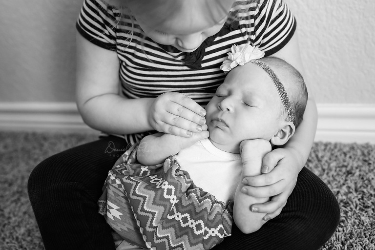 Big Sister Holding Baby Sister | Danielle Parker Photography | Mobile Family Photographer
