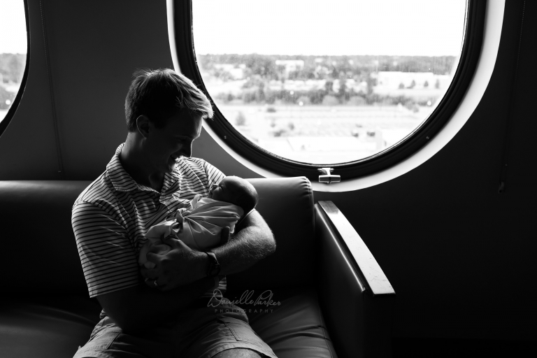 Black and White Photo of Father Holding New Son | First 48 Baby Photography Mobile, AL | Danielle Parker Photography