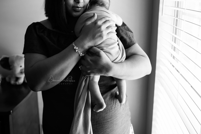 Black and White Photo of Mother Comforting Newborn | Lifestyle Newborn Photographer Mobile, AL | Danielle Parker Photography