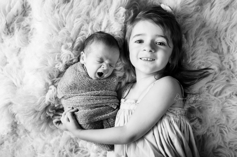 Big Sister Holding Newborn Baby Brother | Danielle Parker Photography | Mobile, AL Newborn Photographer