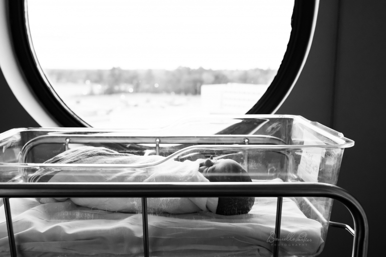 Black and White Photo of Sleeping Newborn in Hospital Bassinet | Mobile, AL Hospital Newborn Photos | Fresh 48 Photographer | Danielle Parker Photography